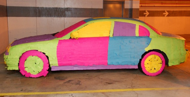 Car covered in Post It notes