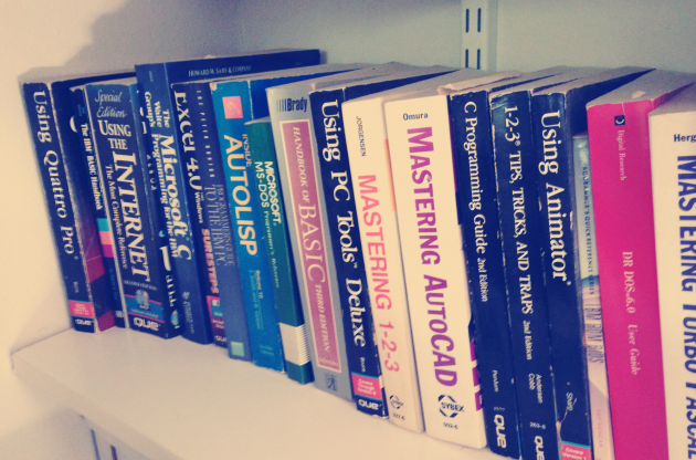 Shelf of old tech reference manuals